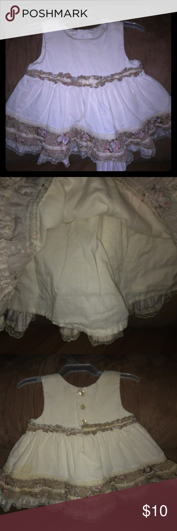 Little girl's dress Courderoy material. Awesome condition. Cream colored with brown. Has lace liner underneath. From smoke free home. Dresses