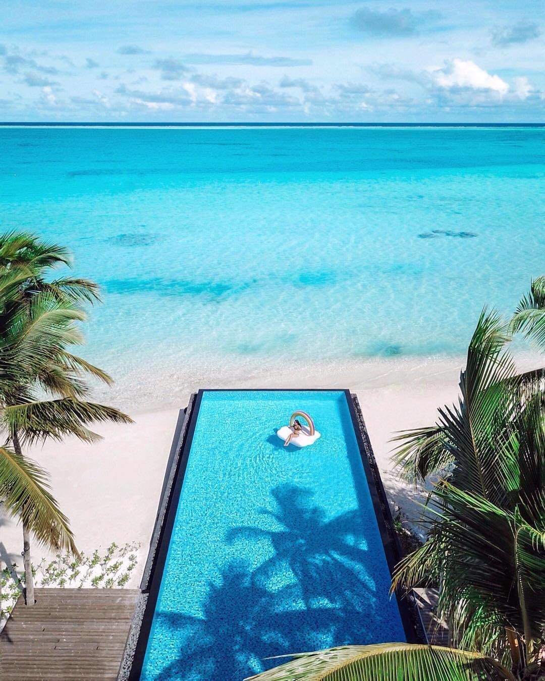 The Maldives The Smallest Asian Country In Land Mass And Population Is Filled With Tropical Islands Pristine Tropical Islands Maldives Travel Maldives Beach