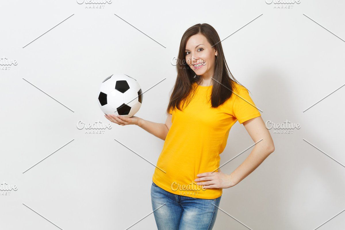 Beautiful European Young Cheerful Happy Woman Football Fan Or Player In Yellow Uniform Holding Soccer Ball Isolated On White Background Sport Play Football Happy Women Football Fans Soccer Ball