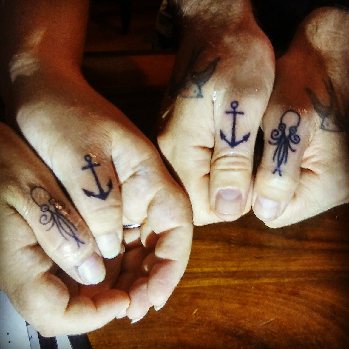 67d8784d028df Thumb tattoos my husband and I got while on vacation in St. Augustine.  Tattoos 6 and 7 for me. Octopus and anchor #thumbtattoo #octopustattoo  #anchortattoo