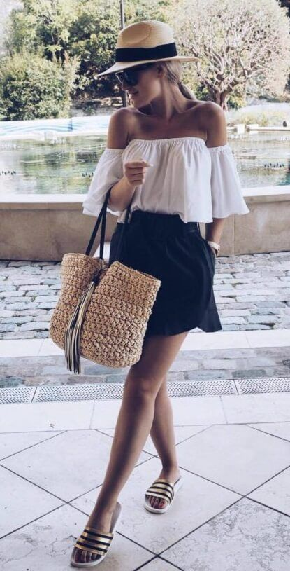 ae6b0c1f42125 Casual blonde woman is wearing a black skirt and a white off-the-shoulder
