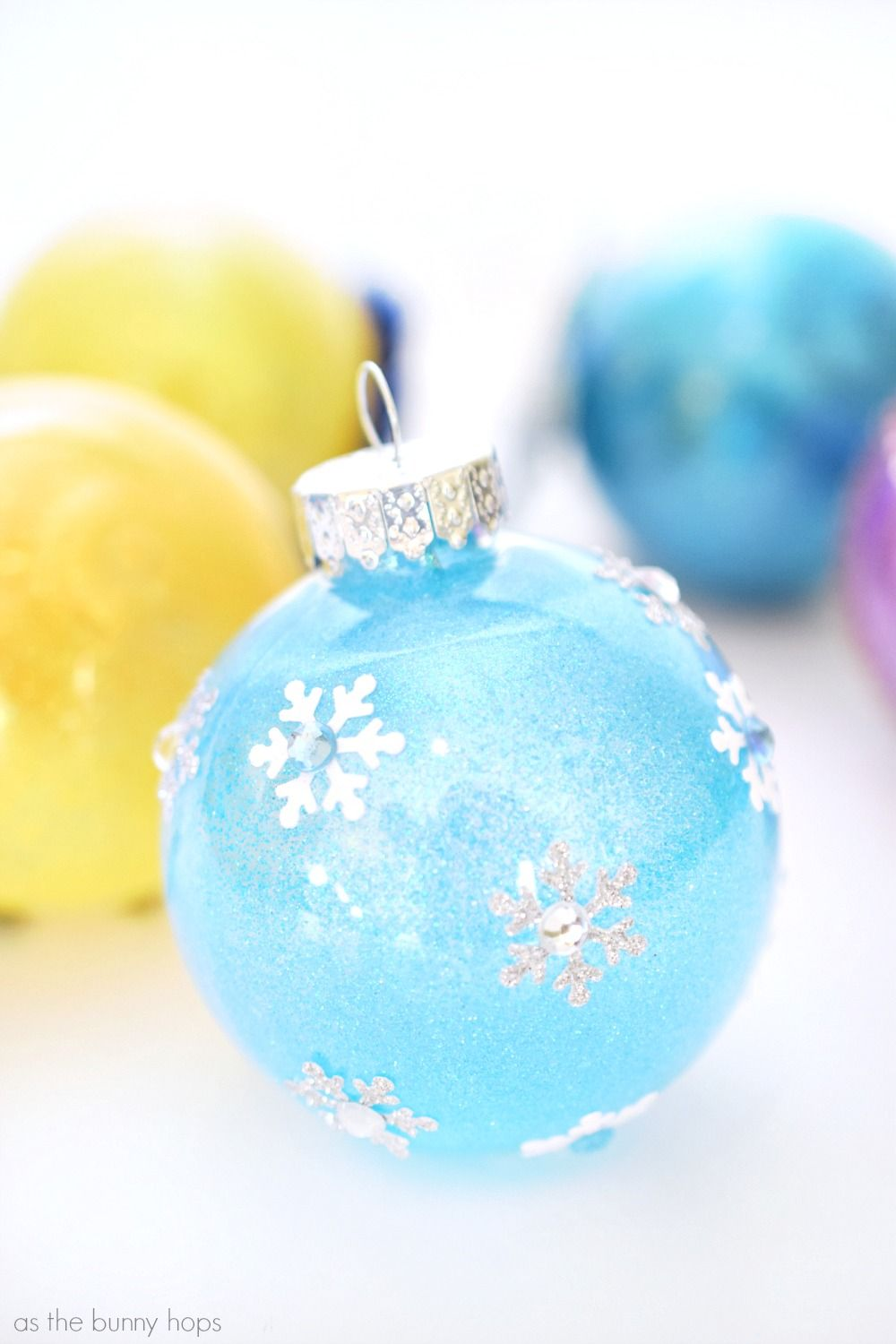 It S Easy To Make These Disney Princess Inspired Christmas Ornament Featuring Snow Disney Christmas Ornaments Disney Ornaments Diy Disney Christmas Decorations
