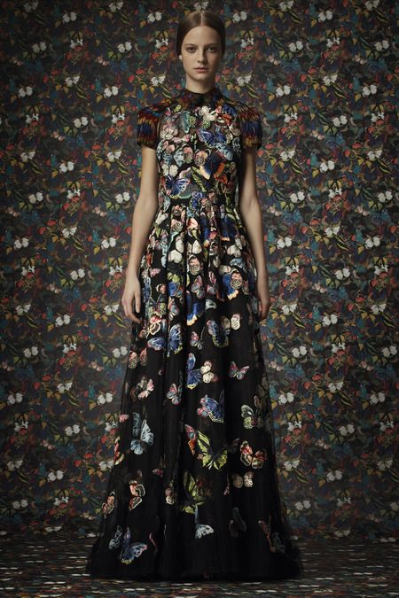 Vivid butterfly printed maxi dress with a colourful print on a dark background; elegant pattern fashion // Valentino