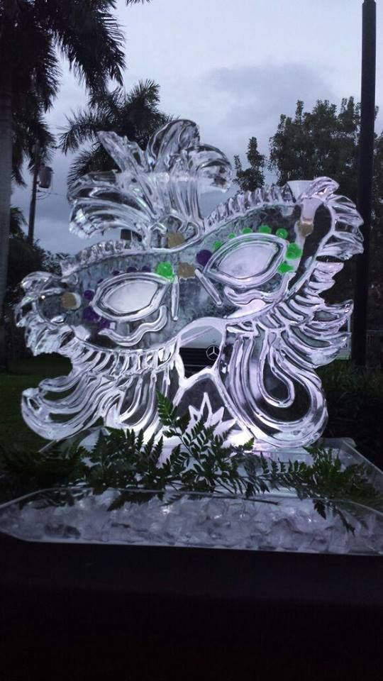 Mardi Gras mask with color filled areas in the sculpture.