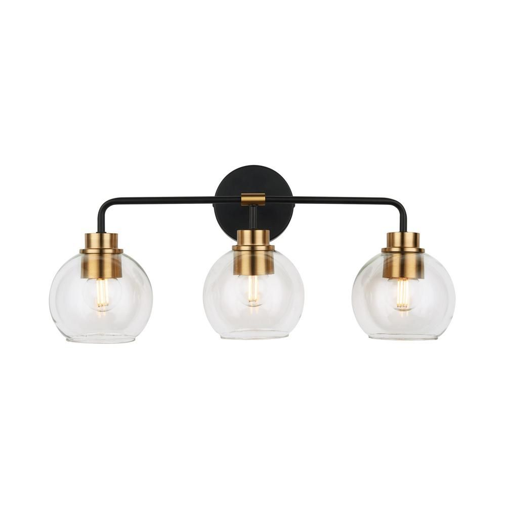 Photo of Home Decorators Collection Lawrence 3-light vanity light made of bronze and brass