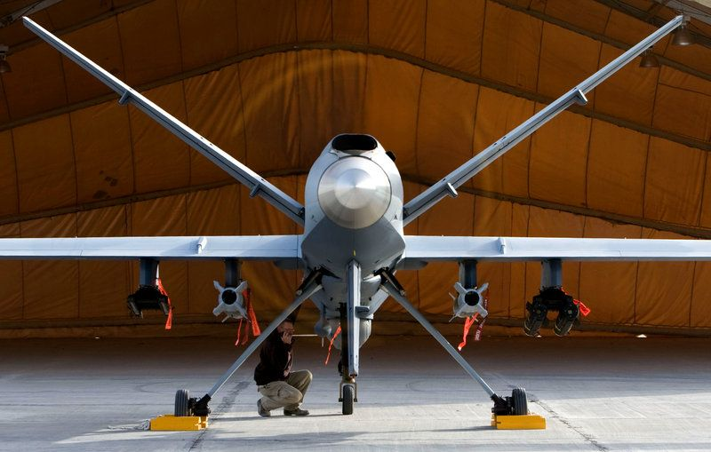 A maintenance airman inspects an MQ-9 Reaper, a high-speed, high-altitude drone, in Afghanistan. National Guard units are beginning to pilot these unmanned aircraft that can conduct intelligence, surveillance and reconnaissance missions.