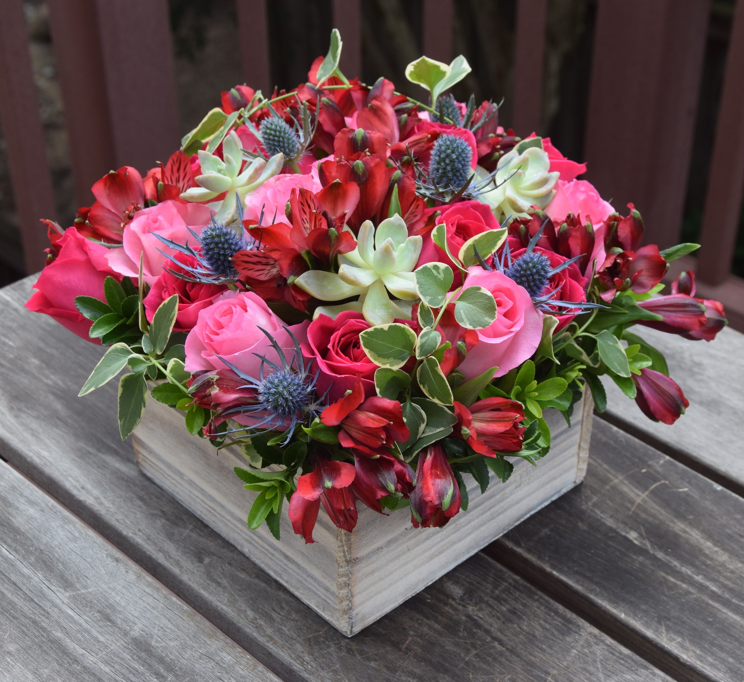 Fresh flower box with alstroemeria, roses, succulent and