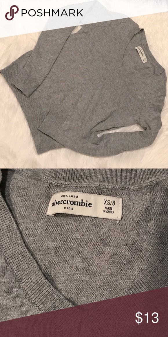 Super cute V neck Abercrombie sweater Such a cute sweater, daughter grew out of it too fast! Only worn a couple of times. In GUC!! abercrombie kids Shirts & Tops Sweaters