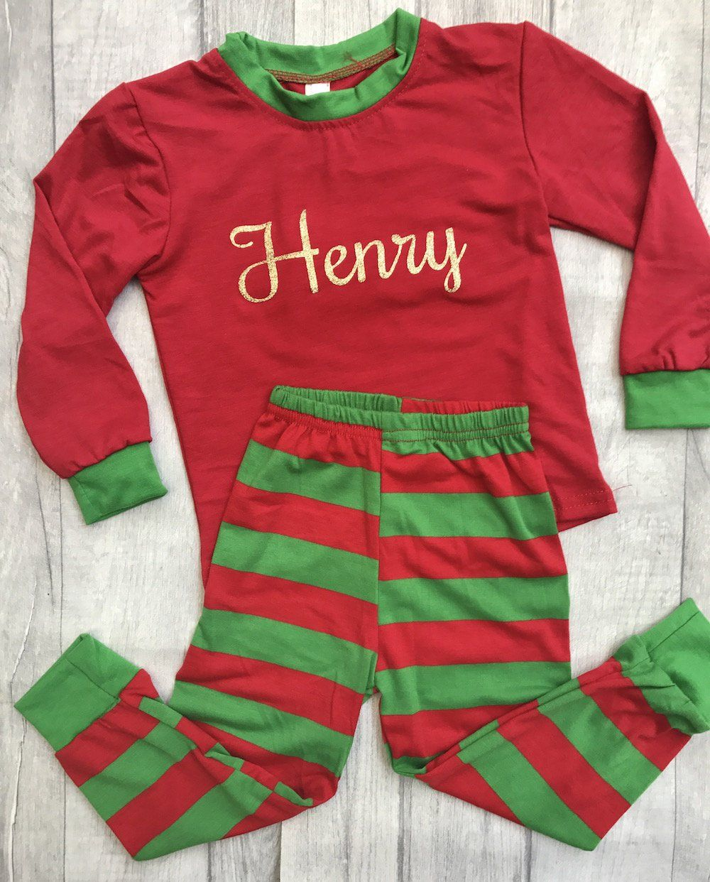 0f6ce8dd Red and Green Striped Christmas Pyjamas with personalised name on the front.