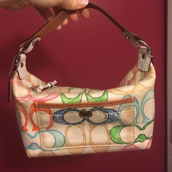 3e1f33e9af Coach multicolored handbag Multicolored classic Coach C purse. White  background with white leather strap