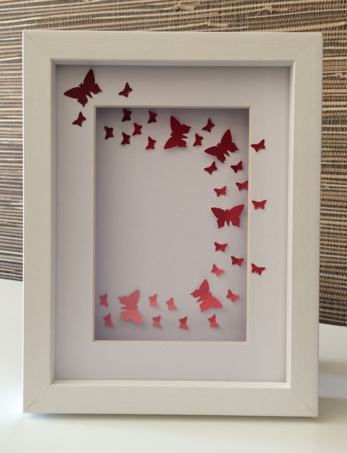 Red butterflies flying in an arc on a white background in a white red butterflies flying in an arc on a white background in a white box frame jeuxipadfo Gallery