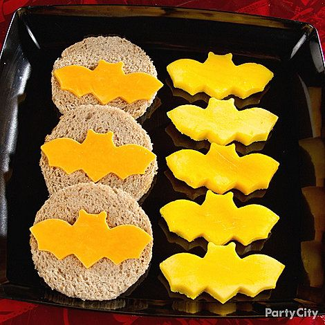 open-face grilled cheese? use a cookie cutter? cut mozzarella slices in the shape of a bat to put on personal pizzas?