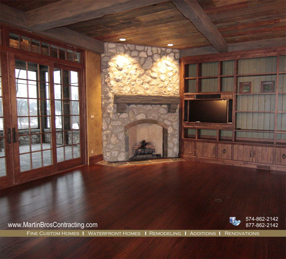 Fieldstone Fireplace With Reclaimed Timber Mantel