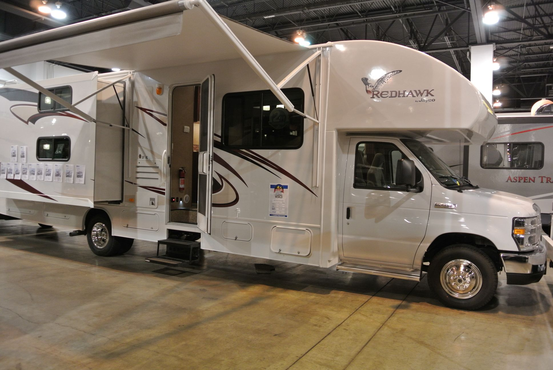 A Class C Rv With The Awning Out At The Show Camping World Rv Sales Camping World Class C Rv