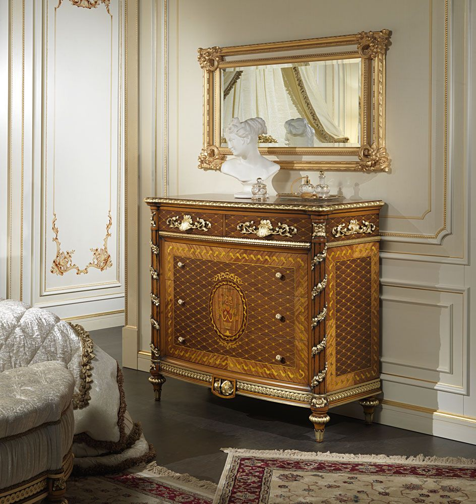 Inlaid walnut chest of drawers with golden and carved mirror of the ...