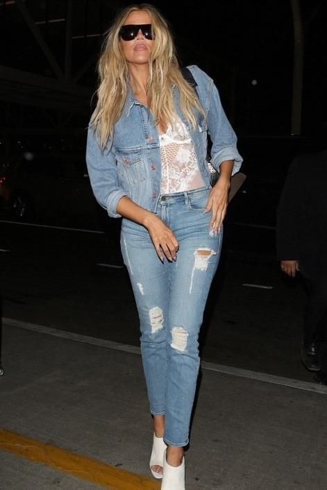 Khloe Kardashian wearing Celine Trapeze Tricolor Python Bag, Gooseberry Intimates Catch Me, Off-White Oversized Denim Jacket and Good American Good Legs Destroyed Skinny Jeans