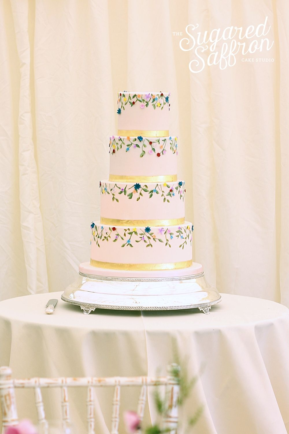 Handpainted flowers and foliage on Pink tiers. Wedding cake by ...