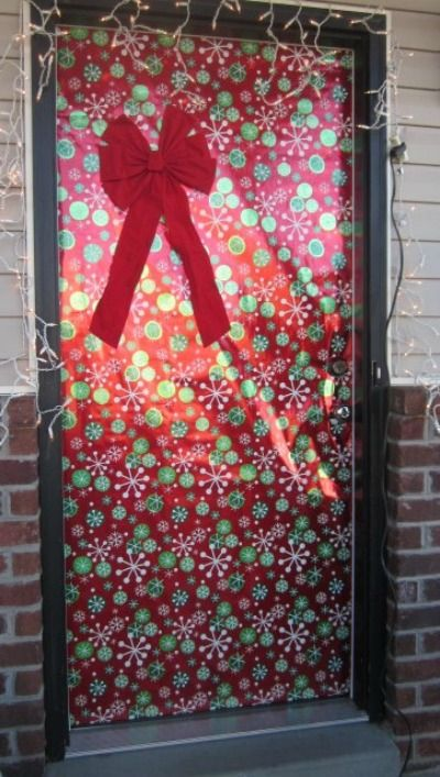 Holiday Decor Wrapping Your Front Door Like A Giant Christmas