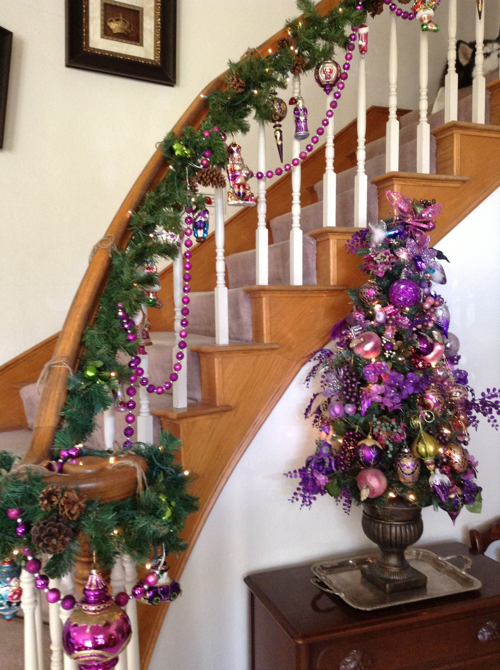This year I hung glass ornaments from the stair railing ...