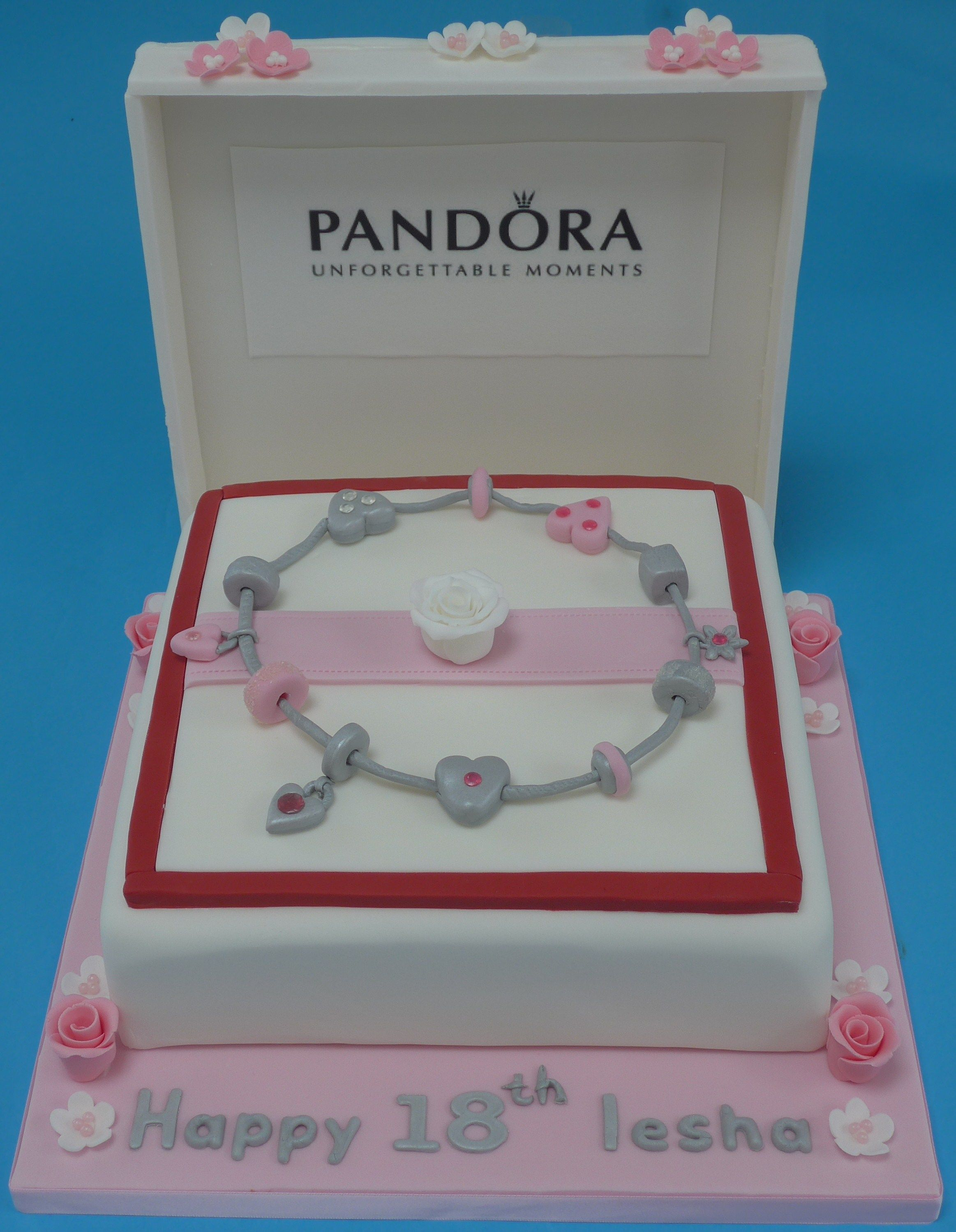 A Pandora charm bracelet cake vanilla sponge covered with