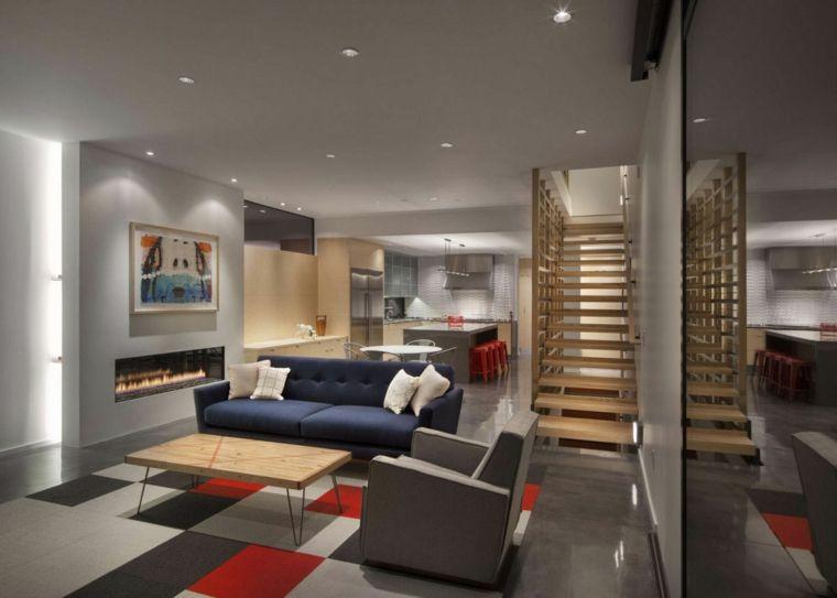 Ampia stanza aperta con soggiorno con camino moderno e zona pranzo
