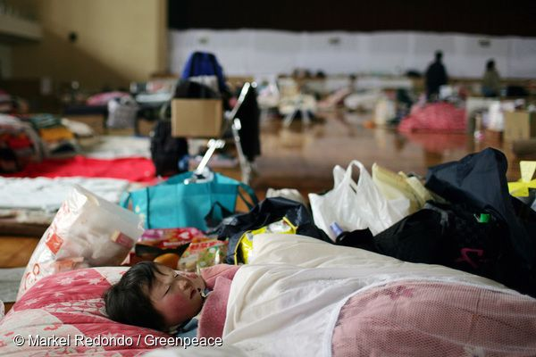 8 Apr, 2011 A child sleeps in an evacuation centre in Yonezawa, 100km from the stricken Fukushima Daiichi nuclear plant. Greenpeace is working in the area to monitor radioactive contamination of food and soil to estimate the health and safety risks for the local population.