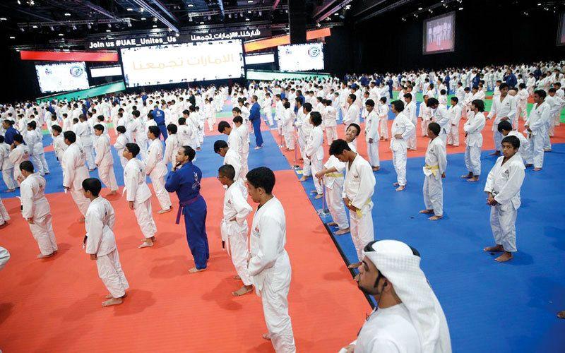 76 ألف طالب في أبوظبي يمارسون رياضة الجوجيتسو الإمارات اليوم Lab Coat Fashion Education