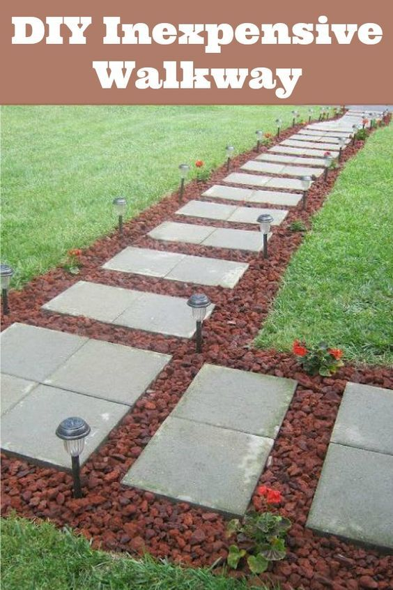 Front walkway built out of inexpensive cement pavers red for Cement garden paths