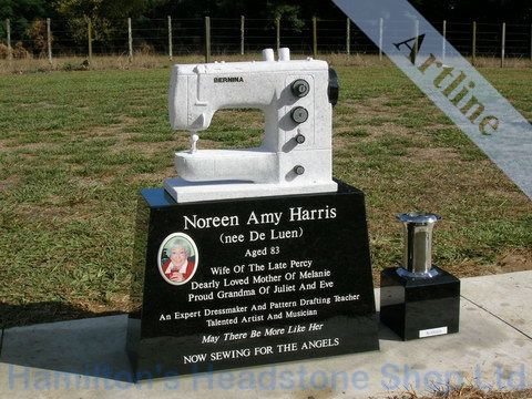 engravings for monuments   White pearl sewing machine carving on top of a black  granite headstone