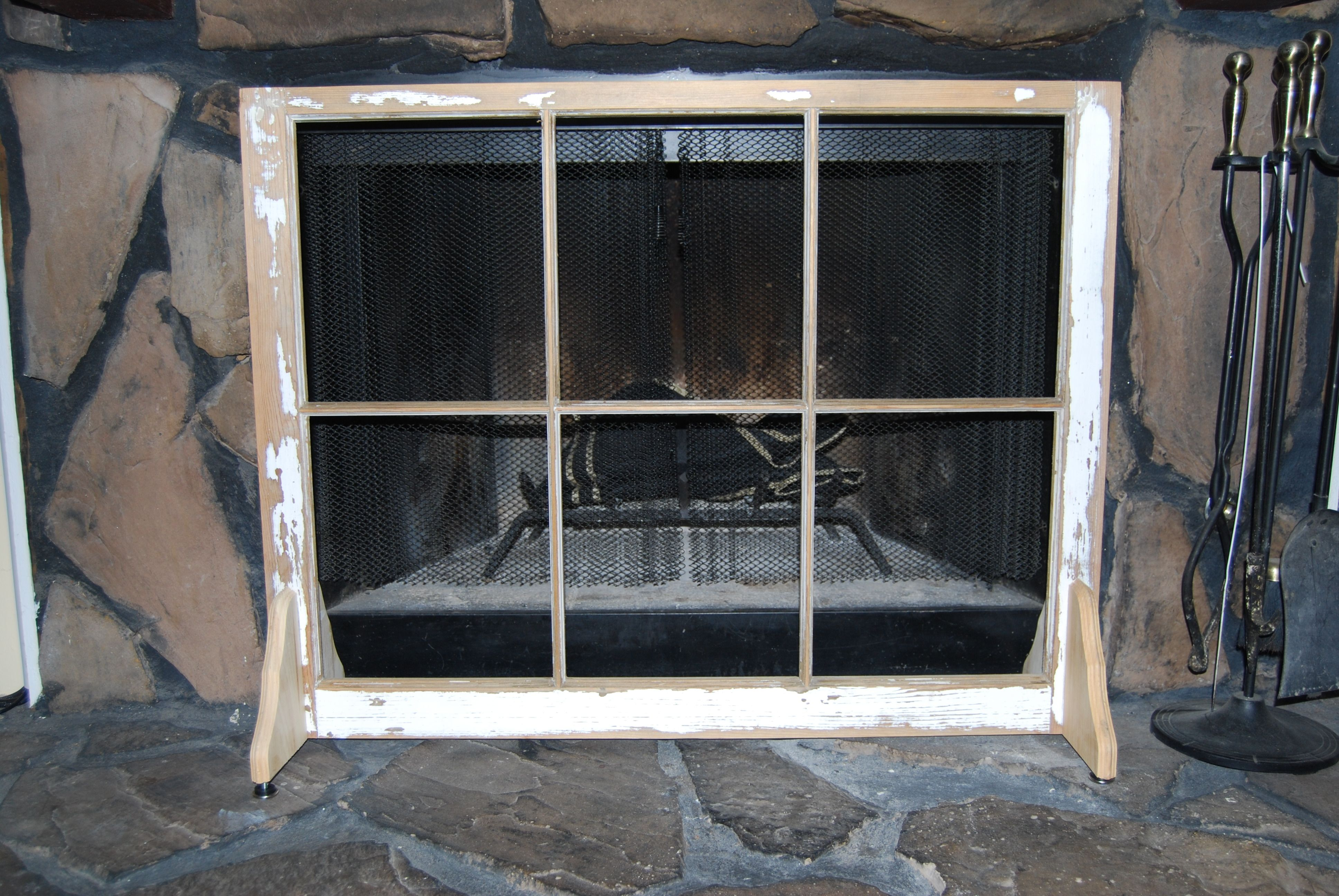 Summertime fireplace screen made from an old 6 pane window frame ...