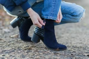 Get ideas for how to wear trendy ankle boots and jeans together, including options for wearing booties with skinny jeans and boyfriend styles.