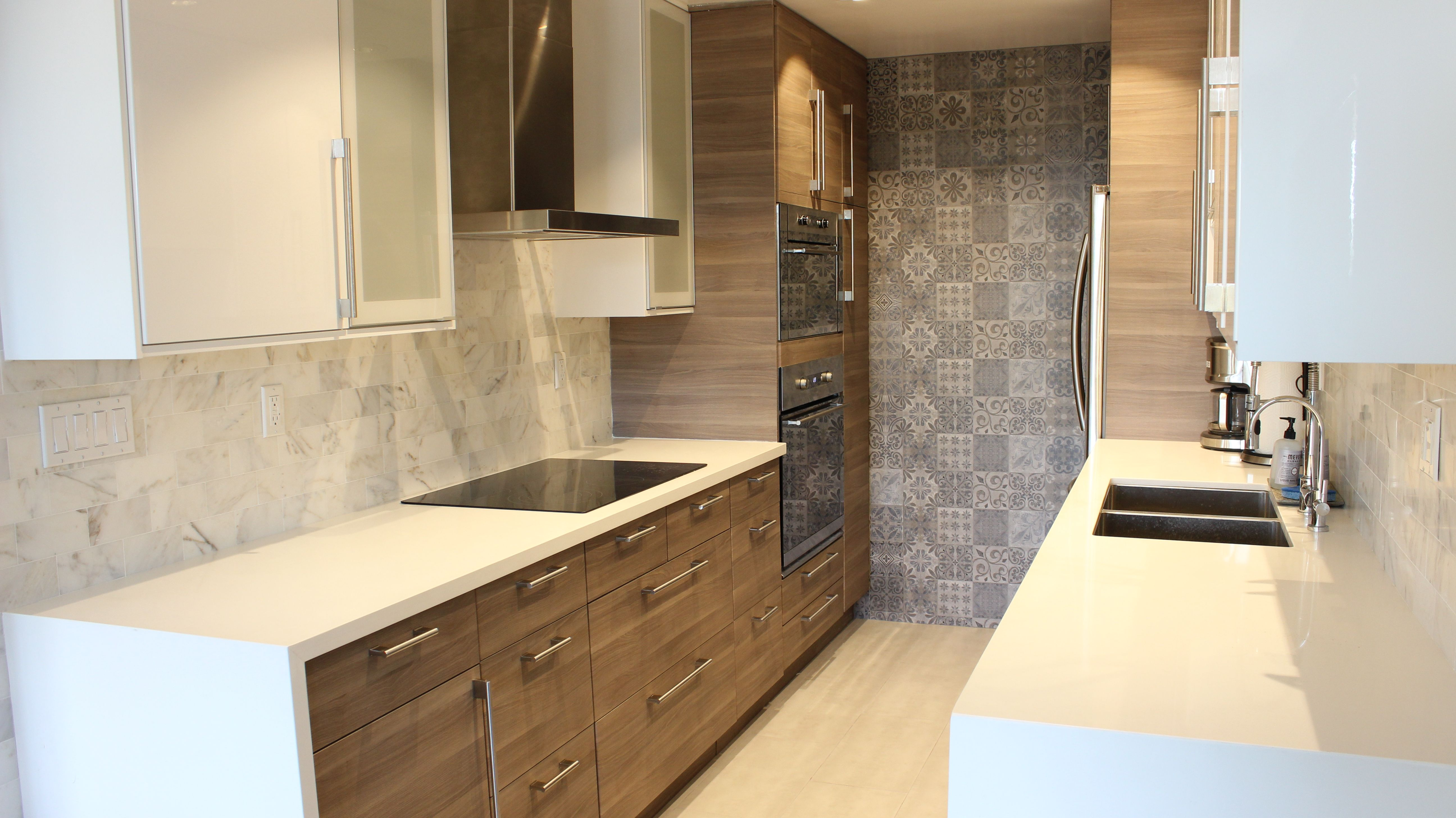 High Gloss White Kitchen Cabinets For The Uppers With Flat Panel Walnut Gray Base Cabinets Featu Simple Kitchen Remodel Kitchen Remodel Design Kitchen Remodel