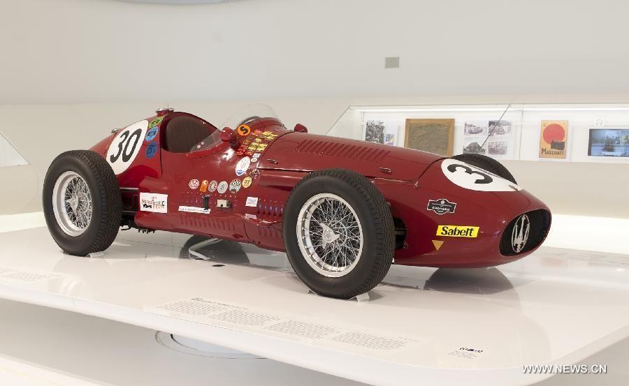 A vintage Maerati car is on display during the \'The Great Challenges ...