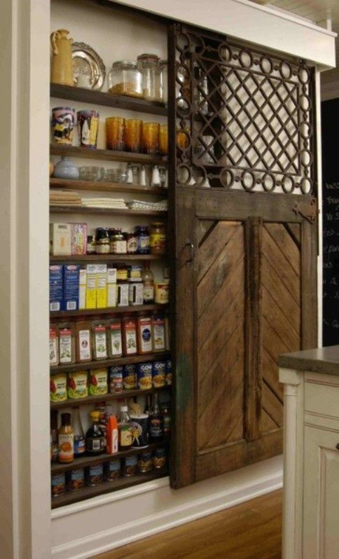 Love the use of this vintage door on a useful pantry.   Spaces ...