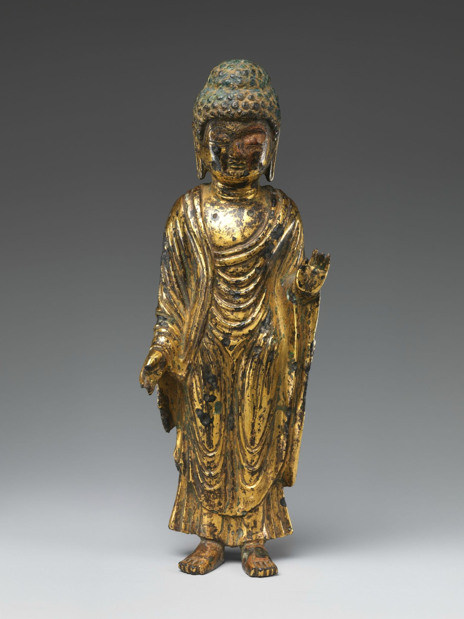 Standing Buddha, South and North Kingdoms period (668–935), Unified Silla, 8th century. Korea. Gilt bronze; H. 6 3/4 in. (17.1 cm). The Metropolitan Museum of Art, New York, Rogers Fund, 1917 (17.118.53) © 2000–2015 The Metropolitan Museum of Art.