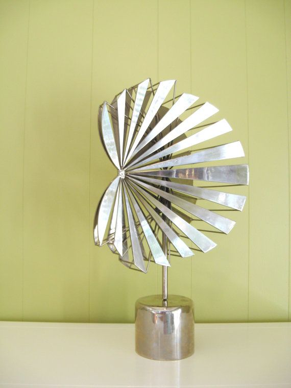 60s - 70s vintage abstract metal sculpture.  made of cut steel with polished chrome finish.