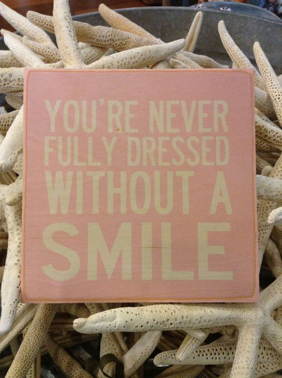 You're Never Fully Dressed Without a Smile Wooden Hanging Sign