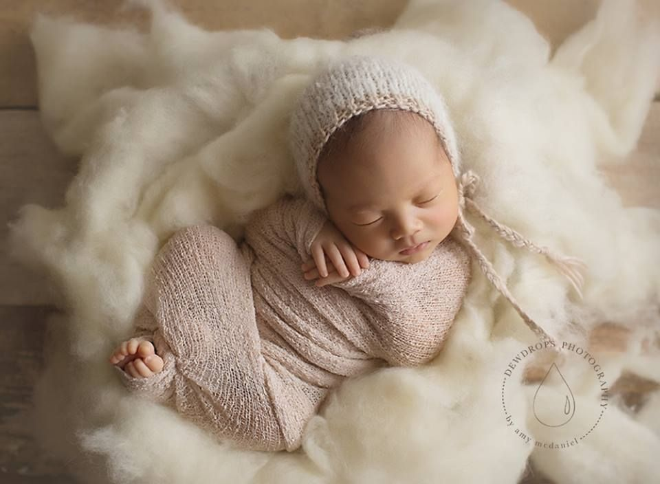 Simply fluff 100 wool batting used as a newborn photography prop this beautiful