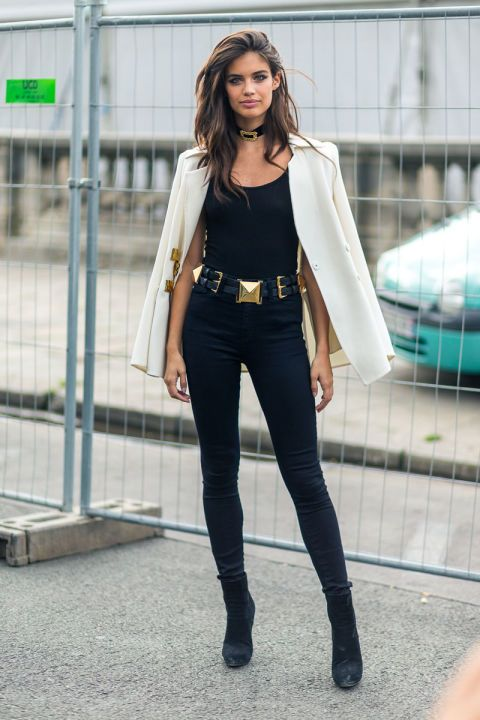 f5c96379f2 How to wear ankle boots  40 outfit ideas to try this season. Sara Sampaio  wears black ankle boots with jeans and a white blazer.