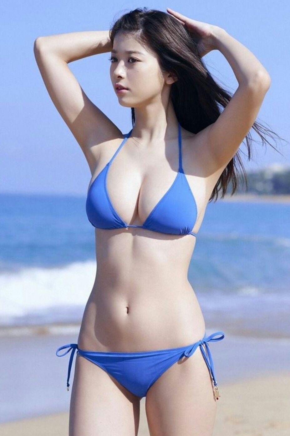 Sexy asian woman in bikini swimsuit posing outdoor poster