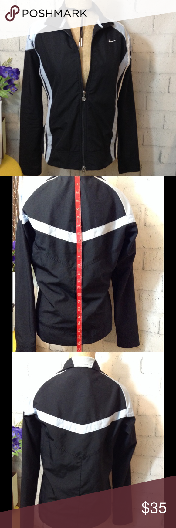 0db2d555495e NIKE⚡️LINED JACKET Size M⚡ Front Zippering with Black and light blue accent  striping. In GREAT condition.Interior pocket. Lined.