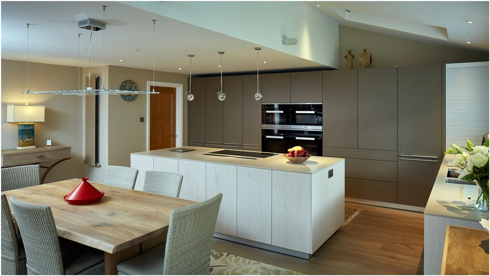 The kitchen boasts the latest appliances from Miele, a cooks dream. The layout of the space ensures the cooking zone is kept separate from the main dining area minimising footflow around the working area.