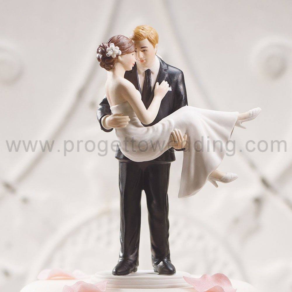 Its Obvious The Bride In Our Swept Up His Arms Wedding Couple Figurine Is Head Over Heels For Her Groom This Romantic Cake Topper