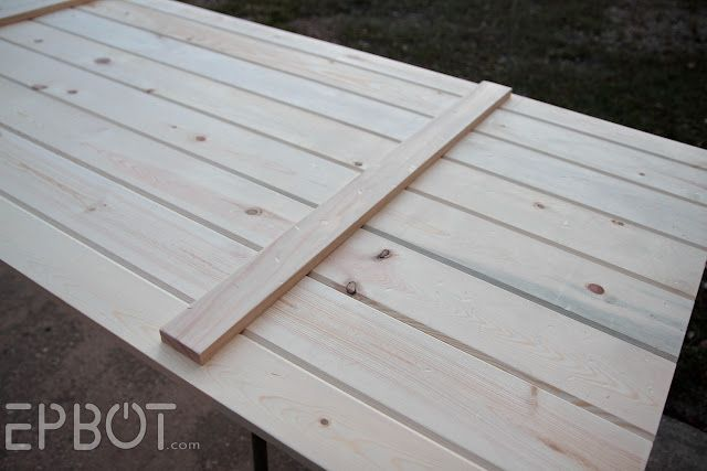 Diy sliding barn door using exterior tongue and groove for Door design with groove