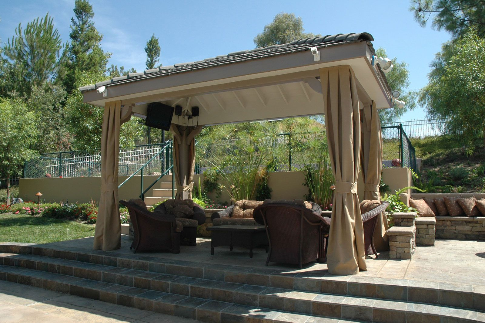 Freestanding solid roof patio cover with drapes Pergola