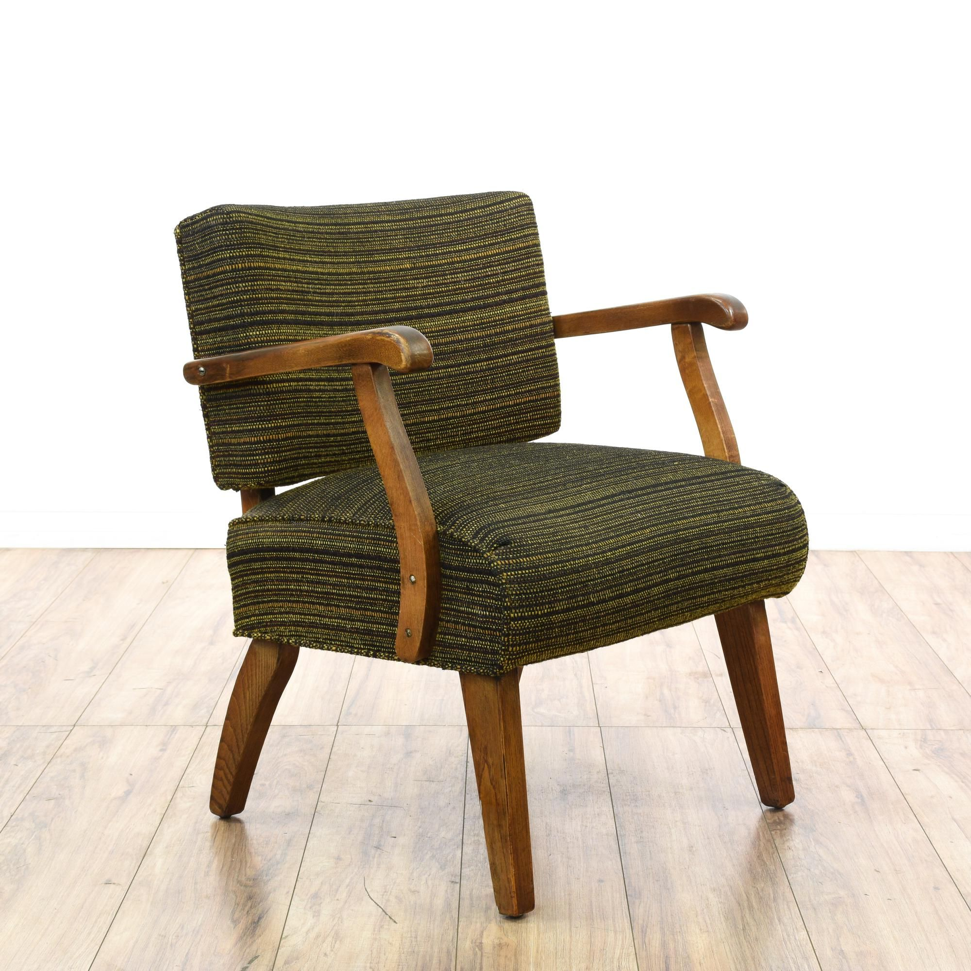 This mid century modern slipper chair is featured in a solid wood