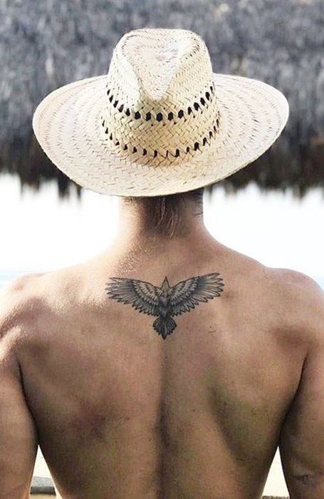 20 Back Tattoos For Men That Make A Statement In 2020 Small Eagle Tattoo Back Tattoos For Guys Small Tattoos For Guys