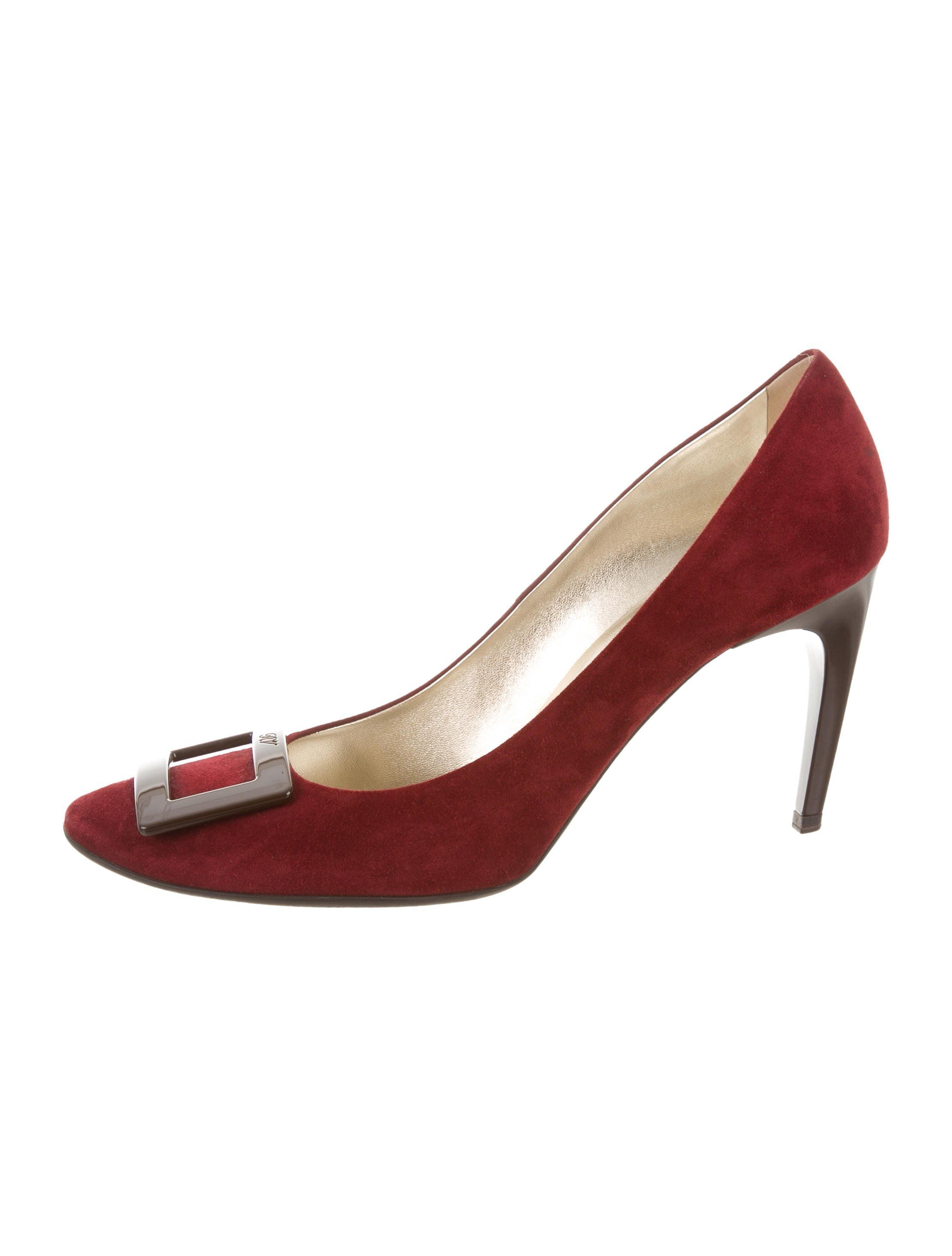 e653559dd136 Burgundy suede Roger Vivier round-toe pumps with gold-tone logo engraved  buckle accents at tops and covered heels.