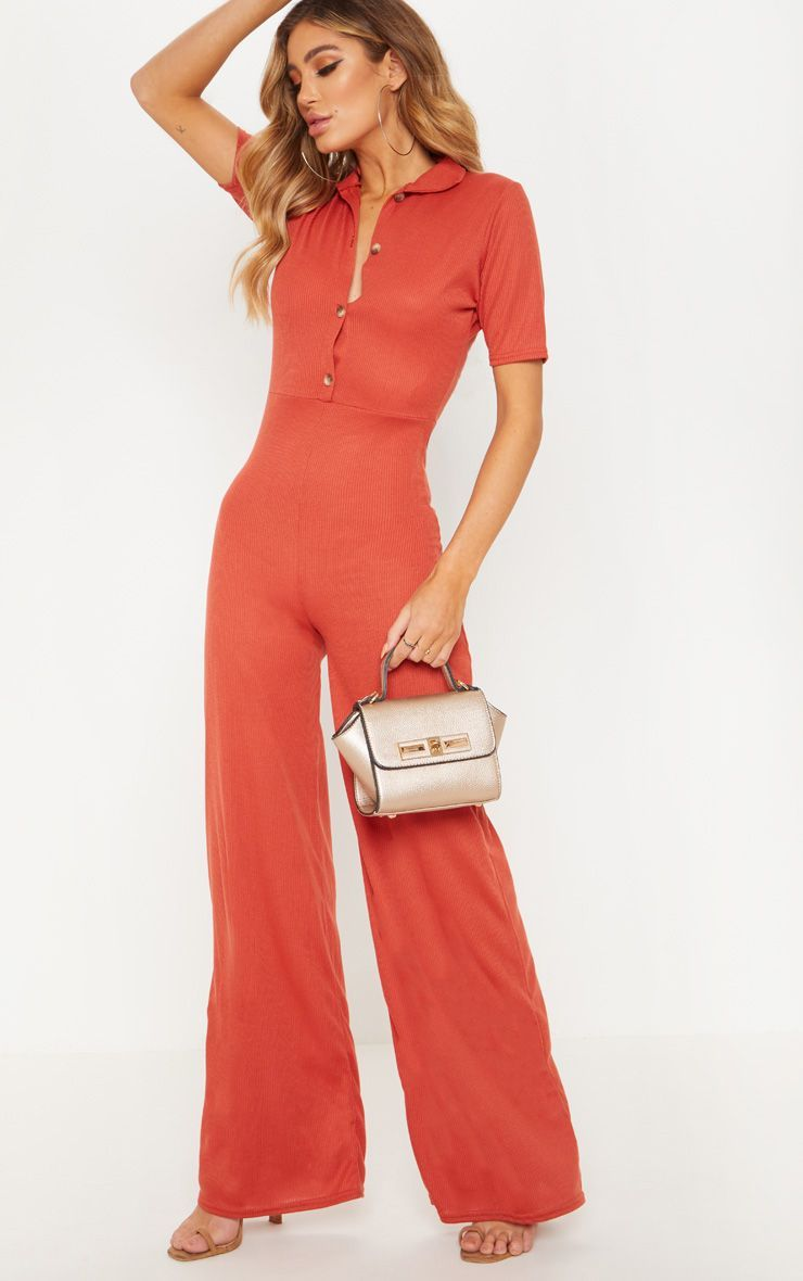 539a307fdd Rust Tortoiseshell Button Ribbed Wide Leg JumpsuitThis jumpsuit is perfect  to dress up or down. F..