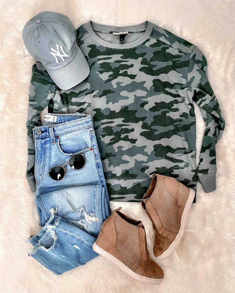 IG: @mrscasual | Camo sweatshirt, ripped jeans, booties, & NY hat
